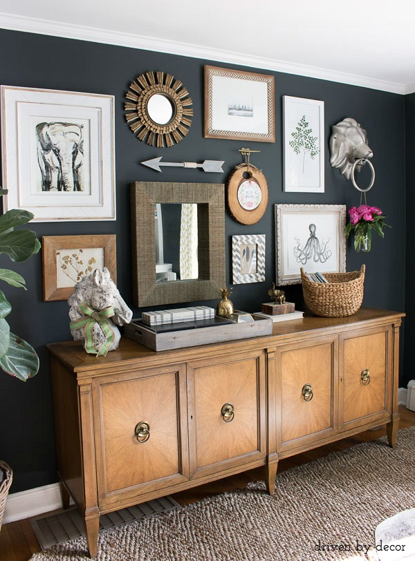 eclectic-gallery-wall-thats-a-fun-mix-of-art-print-mirrors-and-unique-wall-art